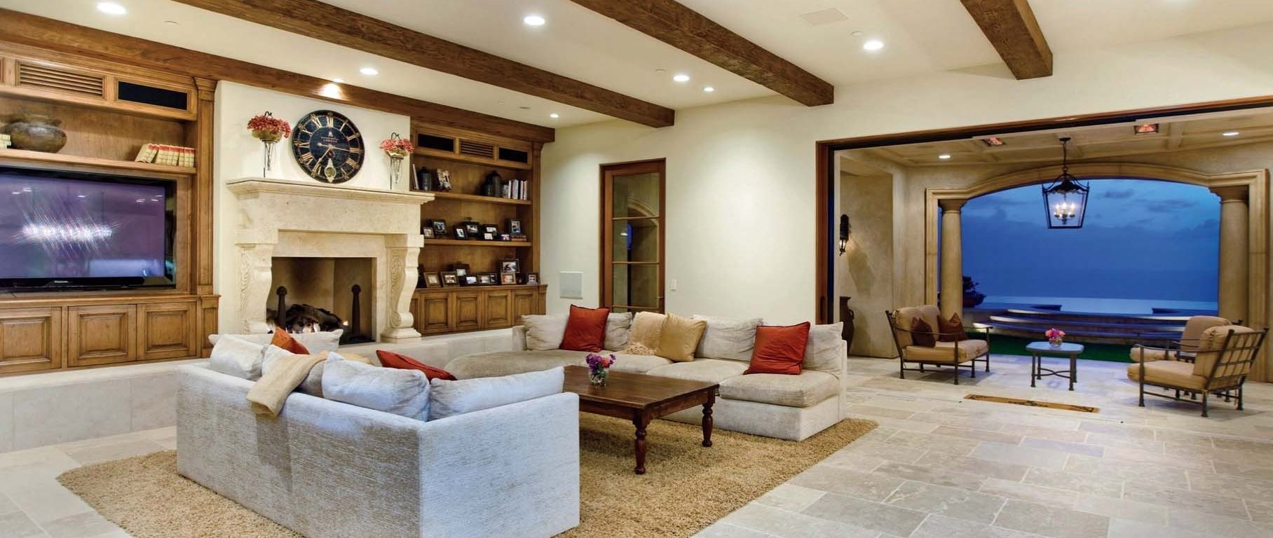 Mediterranean style home reclaimed rustic old natural stone limestone living room hand carved fireplace mantel flooring canada ca Toronto BC