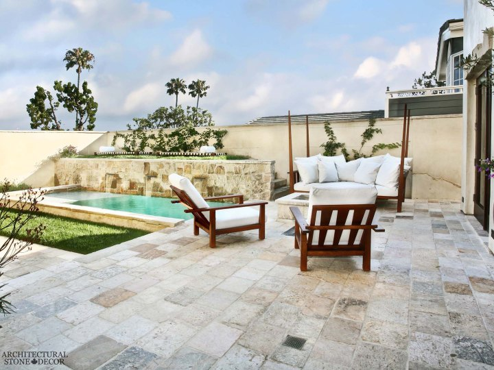 Mediterranean style terrace reclaimed rustic old natural stone limestone flooring pool coping canada ca Toronto BC
