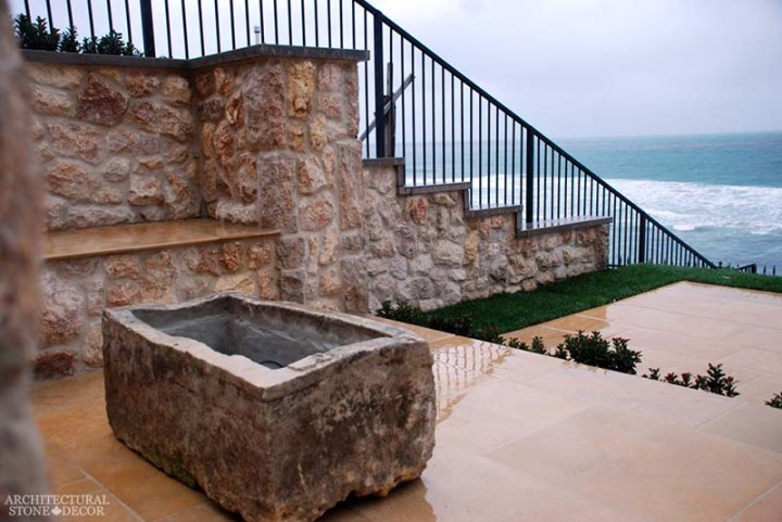 Rustic reclaimed old hand carved limestone natural stone trough fire pit terrace garden backyard ca canada