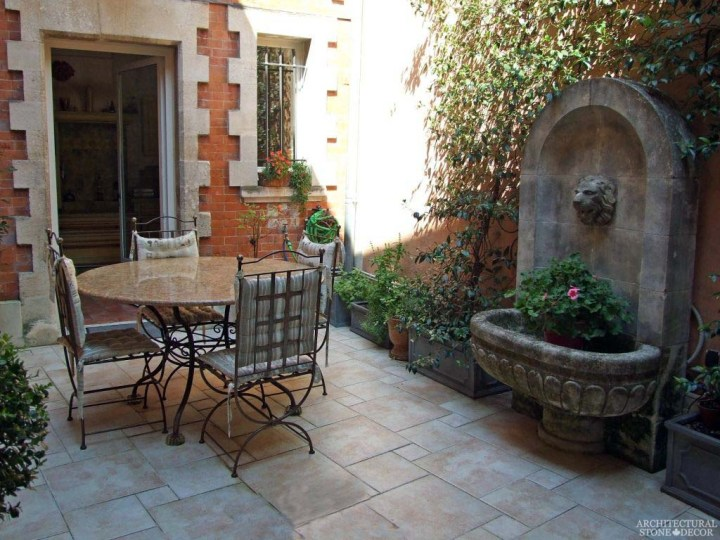 French provence terrace Rustic reclaimed old hand carved limestone natural stone wall fountain flooring ca canada bc usa