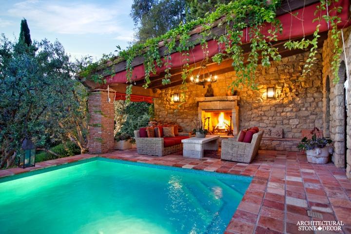 outdoor-limestone-fireplace-with-imestone-pool-coping-slab-canada