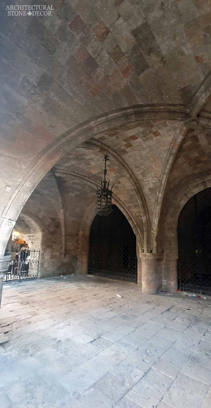 old town Rhodes natural stone flooring ceiling arches columns architecture home interior design Medieval style ca BC canada