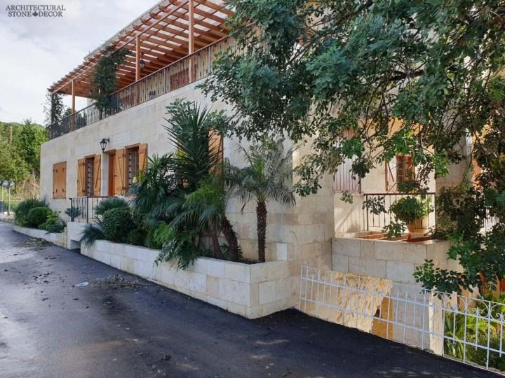 Reclaimed rustic old exterior wall cladding limestone natural stone Mediterranean home villa architecture Canada CA UK USA